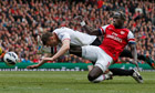 Arsenal's Bacary Sagna challenges Manchester United's Phil Jones