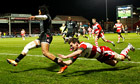 Biarritz'z Teddy Thomas evades Gloucester's Freddie Burns to score in the Amlin Challenge Cup