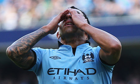 Carlos Tevez cannot bear to look