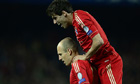 Javi Martínez, right, leaps on Arjen Robben following his goal against Barcelona at Camp Nou