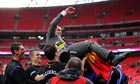 Wigan's manager Roberto Martínez is thrown into the air