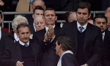 Txiki Begiristain shakes hands with Roberto Mancini after Saturday's FA Cup final