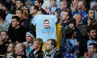 A T-shirt honouring Malcolm Allison is hoisted at a Manchester City match against Arsenal