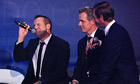 Sergio García, left, talks with Luke Donald and Nicolas Colsaerts on stage at the European Tour Dinn