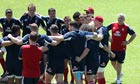 Lions' head coach Warren Gatland outside a huddle by his players