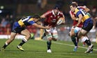 Sean O'Brien, the British & Irish Lions flanker, is tackled by the Combined Country XV's Alex Gibbon
