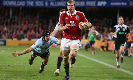 Tom Croft of the Lions breaks clear to score