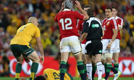 Australia's Christian Lealiifano lies injured