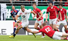 Jack Nowell of England runs of the Wales centre Jack Dixon clear to score a try in Vannes on Sunday.