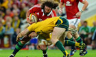 The Lions' Adam Jones does battle with Australia's Pat McCabe during the first Test in Brisbane