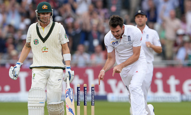 James Anderson points to the stumps after getting Michael Clarke out