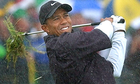 Tiger Woods plays from the rough on the first hole during round three of the 2002 Open