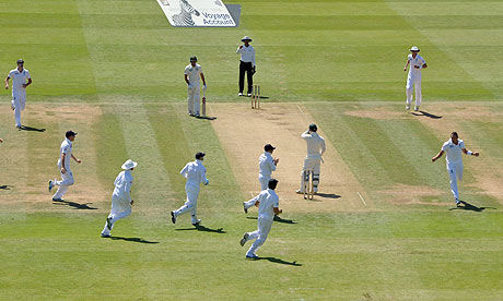 England celebrate the wicket of Phillip Hughes