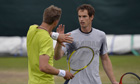 Andy Murray high-fives with a
