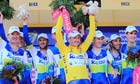 Simon Gerrans wears the yellow jersey and celebrates with his Orica-Greenedge team-mates
