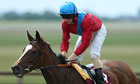 Dank, ridden by Ryan Moore, is a convincing winner at The Curragh