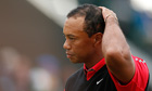 Tiger Woods reacts on the 18th green at The Open