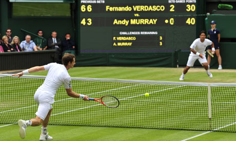 Britain's Andy Murray volleys