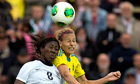England's Anita Asante battles for the ball with Sweden's Charlotte Rohlin