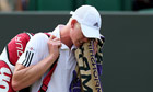 Kyle Edmund reacts as he leaves Court Three at Wimbledon