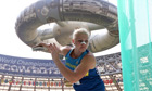 Ukraine's Natalia Semenova in the women's discus at the world championships with a broken nose