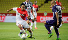 Monaco's Radamel Falcao, left, is watched by Toulouse's Aymen Abdennour
