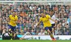 Arsenal's Lukas Podolski, right, celebrates scoring against Fulham in the Premier League match