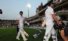 England's Chris Woakes and Matt Prior walk off at The Oval after bad light ended the match