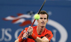Andy Murray hits a double-fisted backhand against Michael Llodra