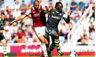 Winston Reid of West Ham United, left, and Kenwyne Jones of Stoke City in the Premier League
