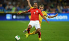 Theo Walcott is brought down by Ukraine's Oleksandr Kucher