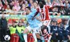 Stoke City's Kenwyne Jones and Samir Nasri of Manchester City in the Premier League