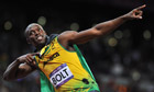 Usain Bolt celebrates winning the men's 100m final at London 2012 Olympics