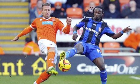 Angel Martínez, left, battles for possession alongside Middlesbrough's Marvin Emnes