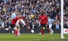 Manchester City's Edin Dzeko, left, scores against Cardiff City in the Premier League at the Etihad