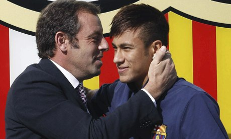 Sandro Rosell embraces Neymar upon the Brazilian's a
