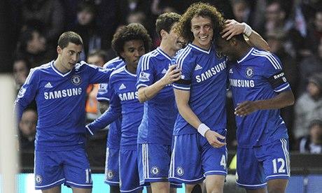 John Obi Mikel celebrates with his team-mates after scoring