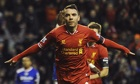 Iago Aspas of Liverpool celebrates scoring his side's first goal
