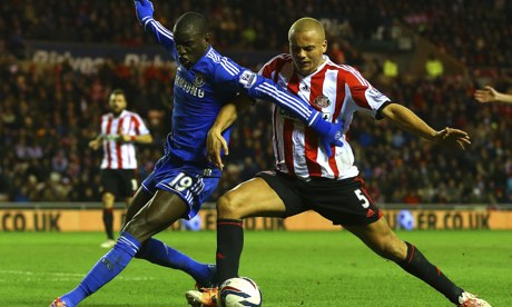Wes Brown, right, challenges Demba Ba during Sunderland's Capital One Cup win against Chelsea