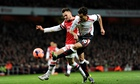 Carl Jenkins, left, and Philippe Coutinho battle during Arsenal's win against Liverpool
