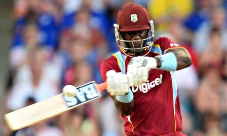 Darren Sammy, the West Indies captain, hits a boundary against England at the Kensington Oval.