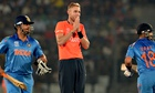 Stuart Broad looks on as Suresh Raina, left, and Shikhar Dhawan run between the wickets
