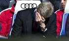 Arsène Wenger can't bear to watch during Arsenal's 6-0 defeat by Chelsea at Stamford Bridge.