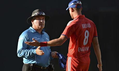England's Stuart Broad and umpire Marais Erasmus in Antigua