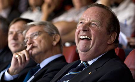 Michel D'Hooghe (R) of the FIFA laughs o
