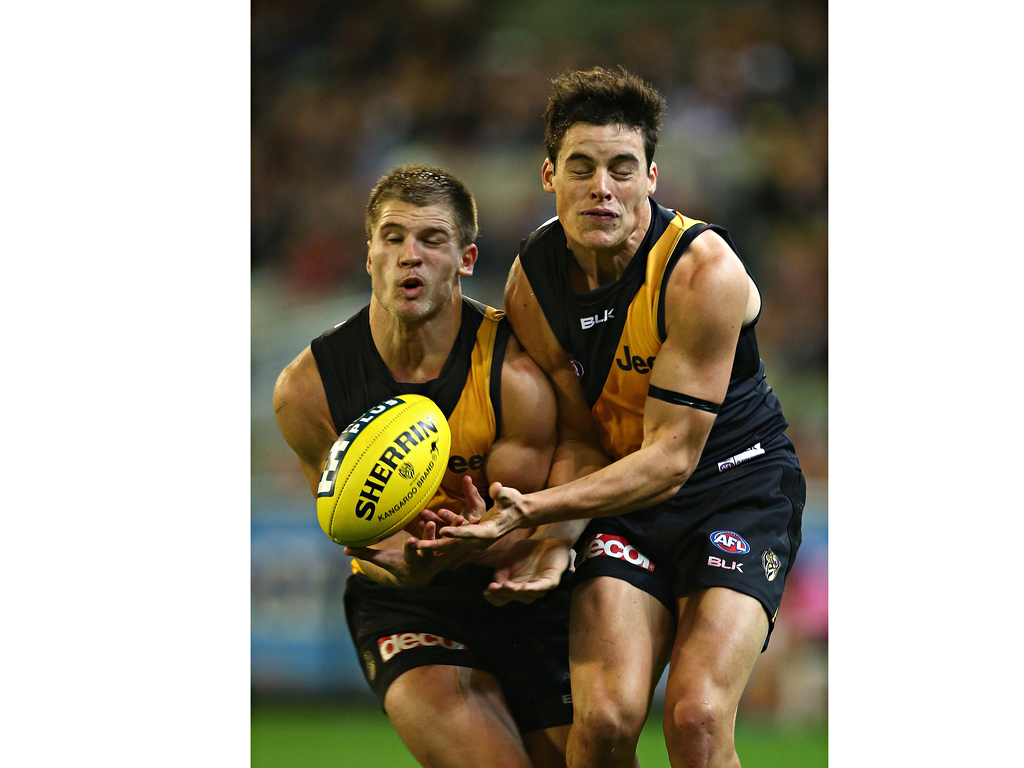 Matt Arnot and Nathan Gordon of the Tigers bump into each other