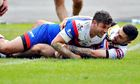 Jon Wilkin grounds the ball for St Helens first try despite the best efforts of a Bradford player.