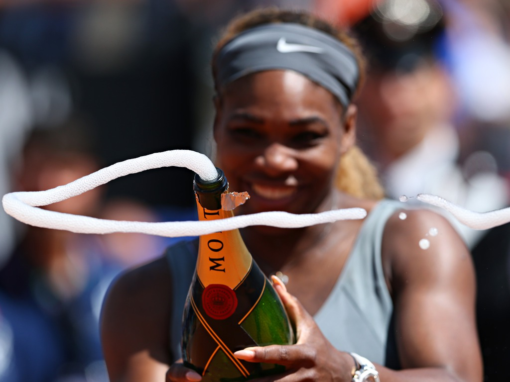 Serena Williams celebrates with champagne