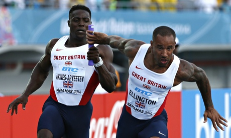 Britain's Harry Aikines-Aryeetey, left, and James Ellington get their changeover right in Nassau.