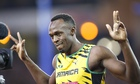 Usain Bolt celebrates after winning the 4x100m relay heat for Jamaica at the Commonwealth Games